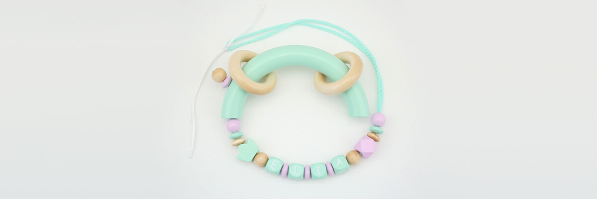 step-by-step instructions grasping ring with name: small wooden rings