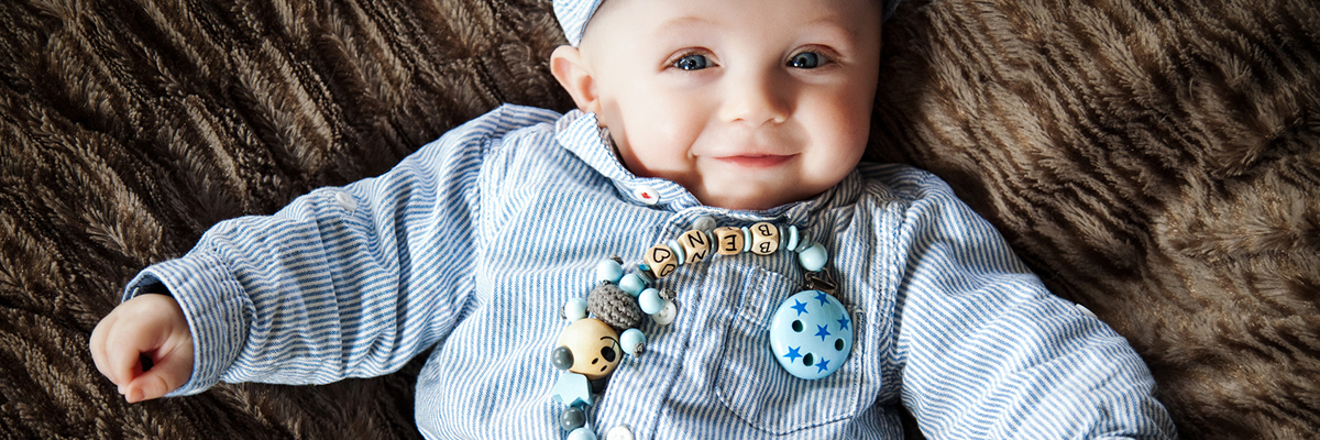 cute baby with dummy chain
